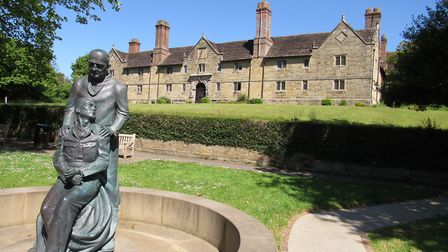 Sackville College with the statue of Sir Archibald