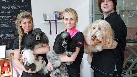 Katie Foye, Laura Bentley and Tom Heaton-Clarke with their charges at The Pet Retreat Grooming Salon