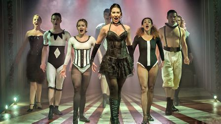 Genevieve Nicole, as Leading Player, leads the ensemble in Pippin at Hope Mill Theatre, Manchester.