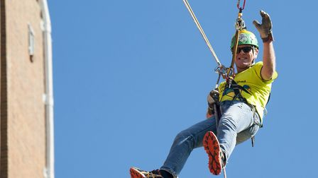 Phil facing his fears to abseil down Guildford Cathedral in aid of The Children's Trust in 2015
