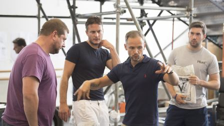 Jack Ryder, centre, in his role as director during rehearsals for The Full Monty