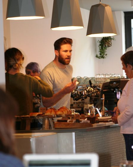 Liam Phillips and team at work in Common Ground, Altrincham
