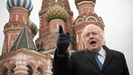 Boris Johnson stands in front of Saint Basil's cathedral in Red square in Moscow. (STEFAN ROUSSEAU/A