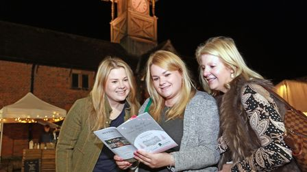 Sian Westby, Sarah Walker-Swift and Rhiannon Walker navigate the Arley Christmas Shopping Spectacula