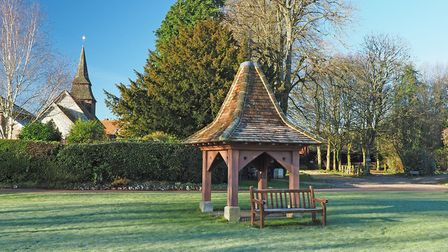 The pyramidal-roofed well head at Hannington, built to commemorate Queen Victoria's diamond jubilee