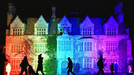 Visitors enjoying the Christmas Lights spectacular at Anglesey Abbey on the Herts-Cambs border (phot
