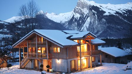 Exterior of the chalet on a snowy evening