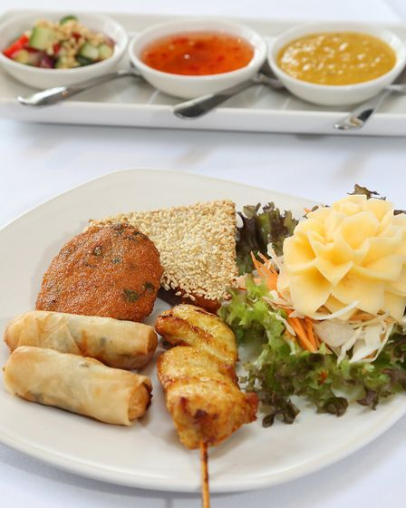 Luam Mid: Mixed Starter Platter: chicken satay, prawn and pork toasts, Thai fish cakes and spring rolls