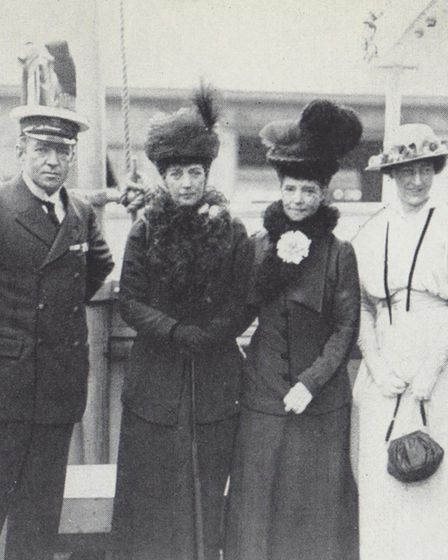 Shackleton earned great fame as an explorer. He is pictured (left) with Queen Alexandra (2nd left),