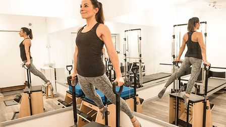 Lucy Whitehead on the Pilates Chair in the One Grove Private Studio