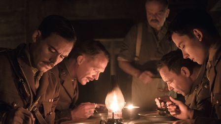 Sam Claflin, Paul Bettany, Toby Jones, Stephen Graham and Asa Butterfield in the candlelit dugout at