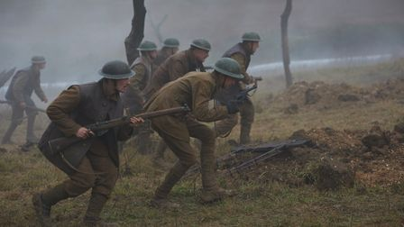 Soldiers move under fire in Journey's End. Photo by Rob Baker Ashton