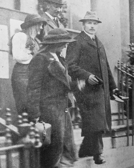 The two convicted arsonists,'Red' and 'Black', coming out of Cheltenham Police Court, Dec. 1913