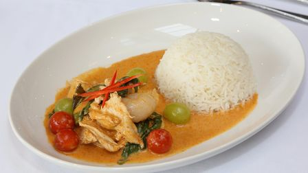 Gaeng Ped Pedd Yang: Red curry with chicken, cherry tomatoes, grapes, pineapple and rambutan