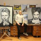 Joe Forrest in his studio with a selection of work