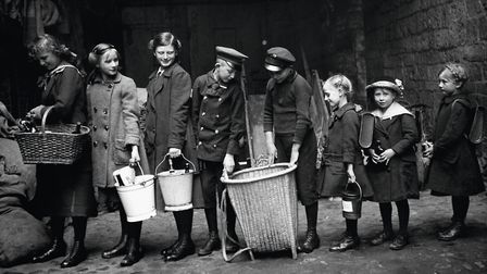Children Queuing to Deliver Recovered Glass Bottles, c. 1915 by Käthe Buchler