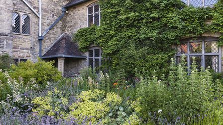 John Challis and wife his Carol have restored the ancient abbot's lodging and garden at Wigmore Abbe