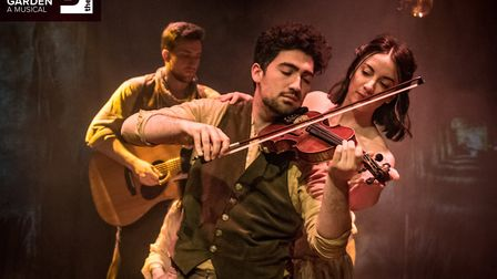 Steffan Rizzi (Ensemble) with Jaimie Pruden (Lily Craven), in background Jamie Ross (Ensemble)