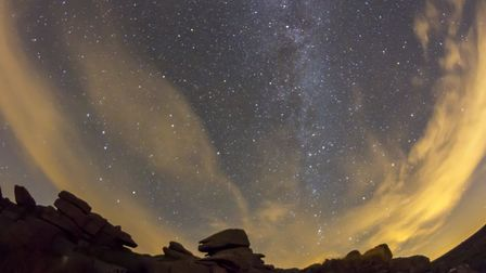 The Milky Way taken with a fish eye lens, showing light pollution effects on clouds
