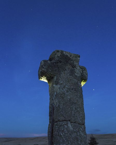 Nuns Cross, painted with torchlight from behind with Venus to the right of the cross