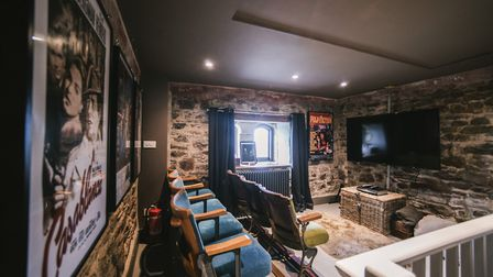 The cinema room, complete with authentic seats