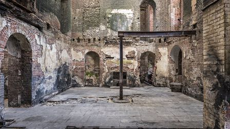 A ground floor room showing extensive fire damage at Clandon Park, Surrey _National Trust Images, An