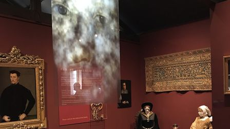 Katherine Parr's ghostly figure appears over items, such as her prayer books