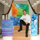 Aubrey Higgin with a selection of his work