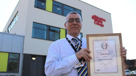 John Revis, Head of Occupational Safety & Health with the Gold Award from RoSPA