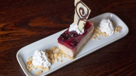 You can even indulge in a cherry bakewell 'cheezecake' served with soya whipped cream (photo: Manu P