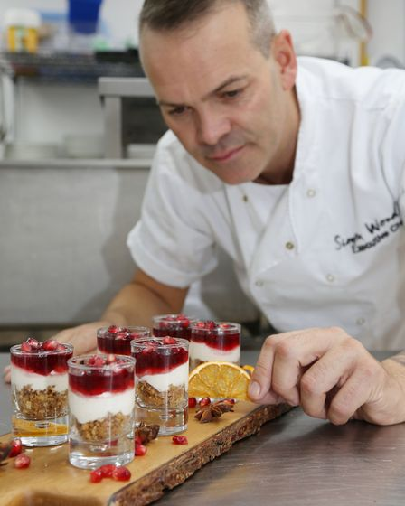 Simon Wood adding the finishing touches to the cranberry and orange cheesecake shots