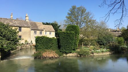 The view from the medieval bridge of the River Windrush