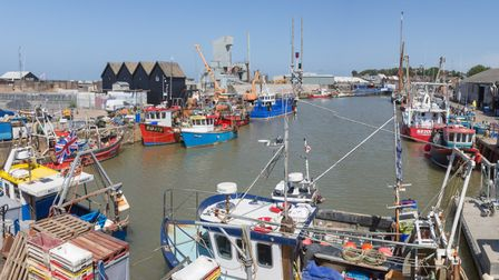 Whitstable harbour is still a working site bustling with fishing boats (photo: Manu Palomeque)