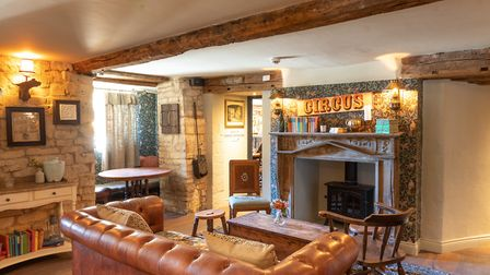 The site''s former bar area transformed into a cosy snug complete with open fire (c) Nick Osborne