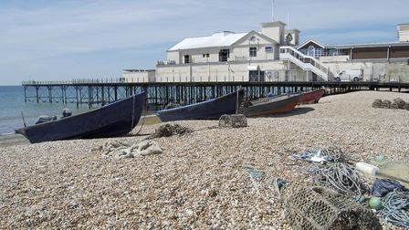 Fishing boats and lobster pots on shingle beach by the pier at Bognor Regis (Nickos/Getty Images/iSt