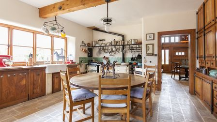 Mason David Hall made the stone column of the kitchen table, and Adrian Mustoe made all the cabinetr