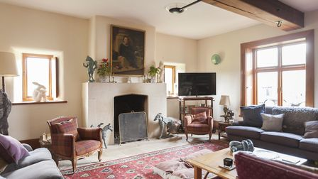 Sophie bought the knoll sofa from an antique shop in Cirencester. The Tudor-style fireplace and othe