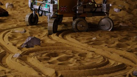 The tracks left by the mars rover replica as it is controlled by British astronaut Major Tim Peake f
