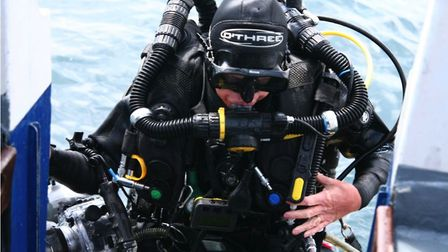 A diver takes to the ocean