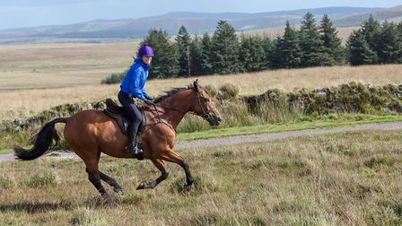 Sara Cox riding out with a magnificent Dartmoor backdrop behind her