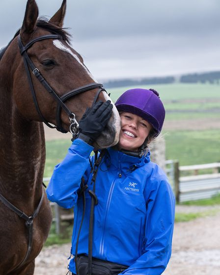 Sara Cox relaxes after an enjoyable day's riding on Dartmoor