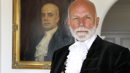 Charles Martell, the High Sheriff of Gloucestershire, by a portrait painting in his house of a famil