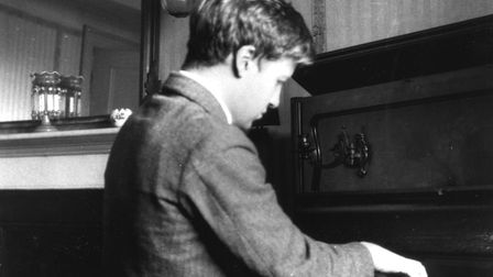 William Golding playing the piano c. 1928 (he got the job at Maidstone Grammar School because of his