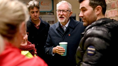 Labour Party leader Jeremy Corbyn and former Labour leader Ed Milliband (second left) speak with flo