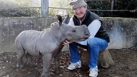 Baby rhino Tinkerbell, at just a few hours old, with Reggie Heyworth, managing director of the Cotsw