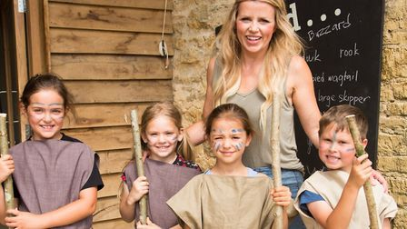 Ellie Harrison with children in Iron Age costume (c) Anne-Marie Randall Photography