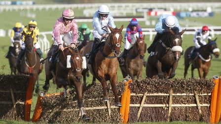Magic Dancer ridden by Richard Patrick (L) clears the last flight before going on to win The Fairlki