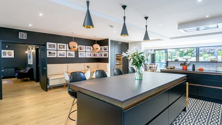 The open plan dining-kitchen room is off the large hallway and opens to the garden (photo: Savills)