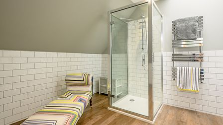 Colourful chaise longue gives a fun edge to one of the en-suite bathrooms (photo: Savills)