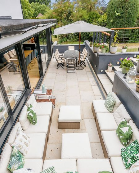 The glass side extension opens to an outside entertaining area and the mature gardens beyond (photo: